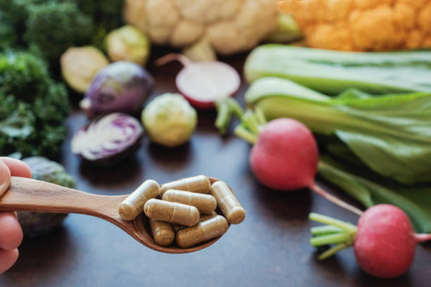 cruciferous vegetables capsules, dietary supplements for healthy eating stock photo