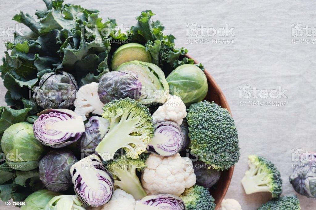 cruciferous vegetables, cauliflower,broccoli, Brussels sprouts, kale in wooden bowl, reducing estrogen dominance, ketogenic diet stock photo