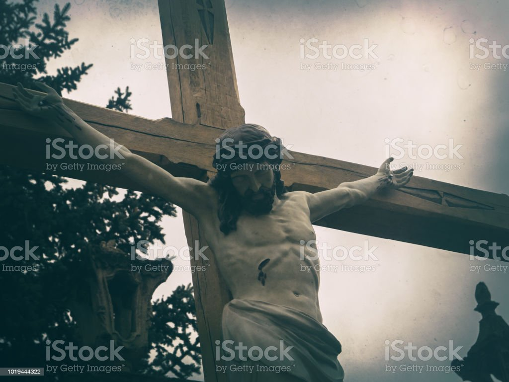 Crucified Jesus Christ on the background of a gloomy sky. Background