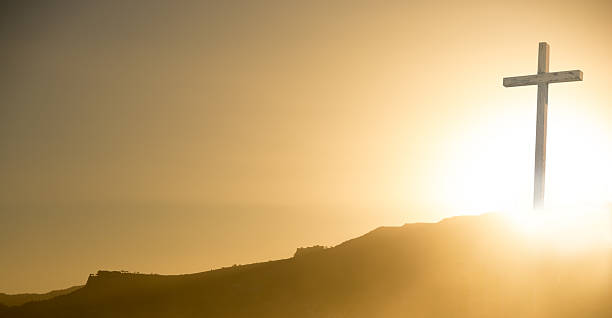 crucifix at sunrise on easter morning- copy space - cross stock photos and pictures