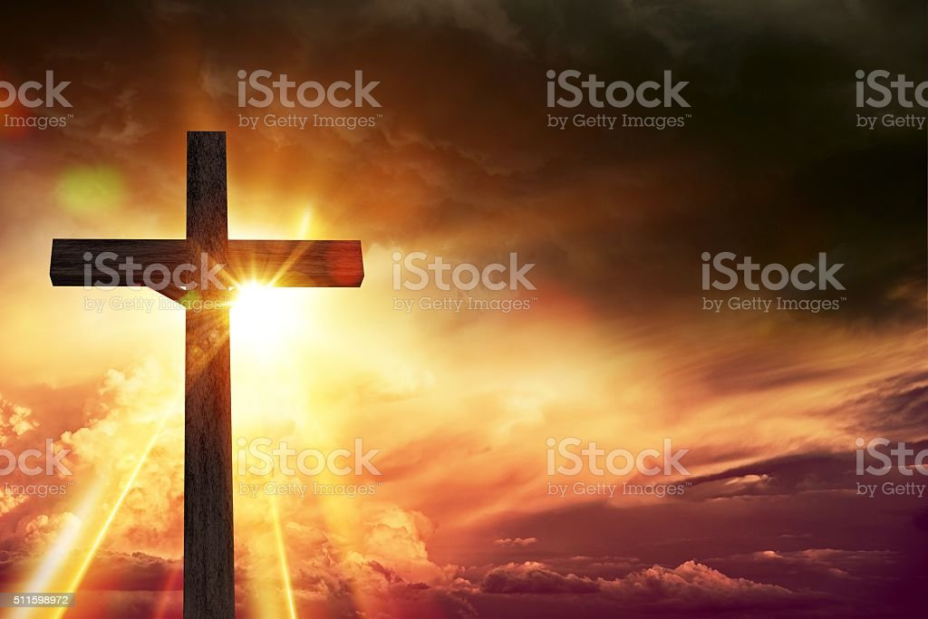 Crucifix Blessing Lights Background. Large Wooden Crucifix at Sunset...
