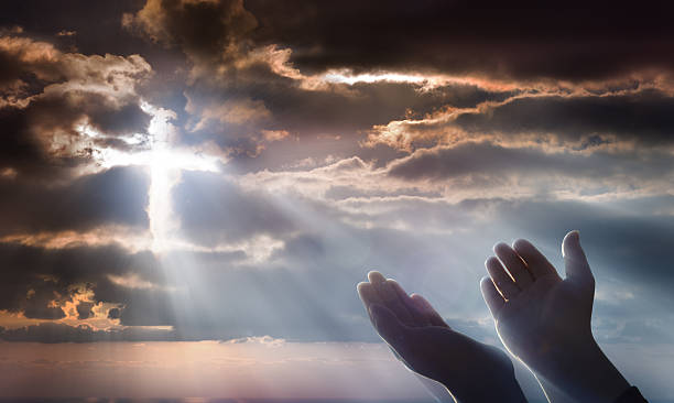 crucifix from heaven - faith and prayer - god stock photos and pictures