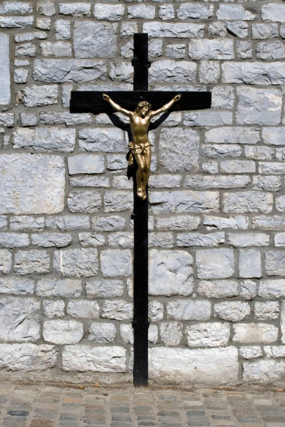 Crucifix in front of a wall stock photo