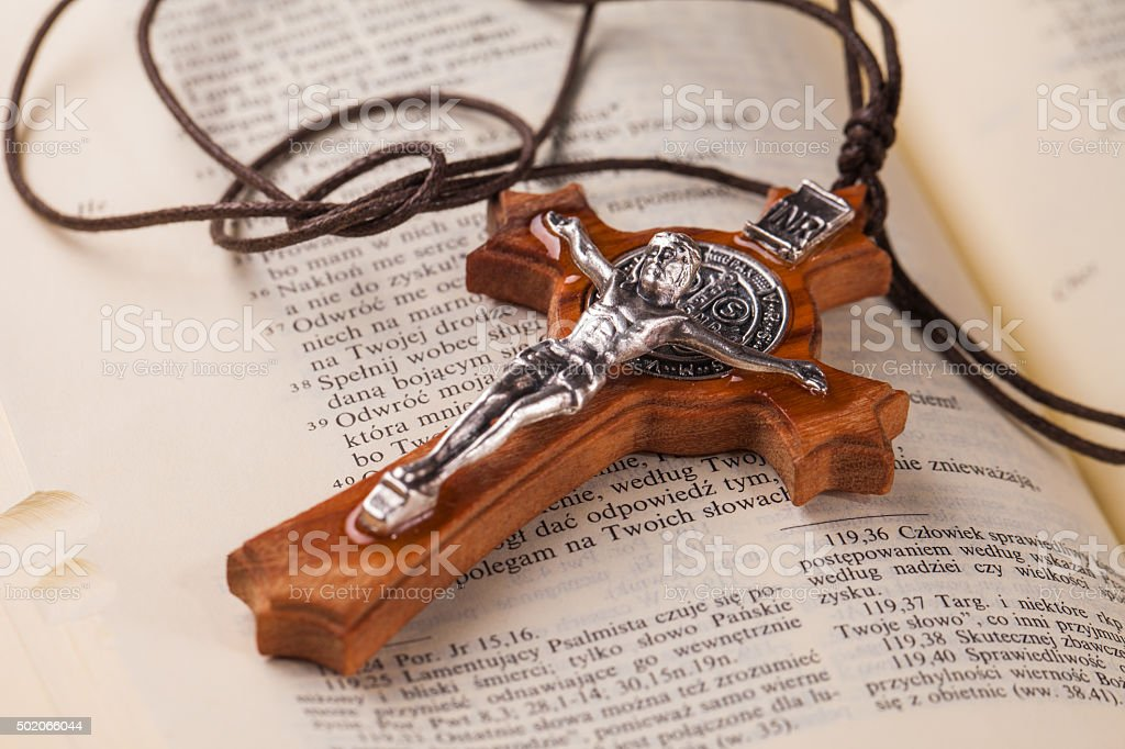 crucifix on holy book stock photo