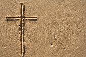 crucifix on sand