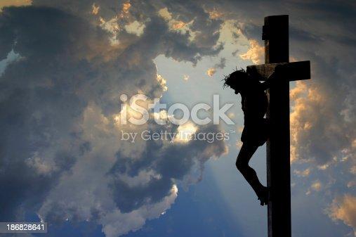 Crucifix against a dramatic sky