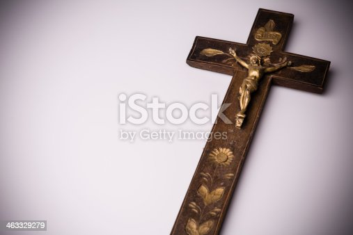 istock Crucifix with figure of Jesus on white background 463329279