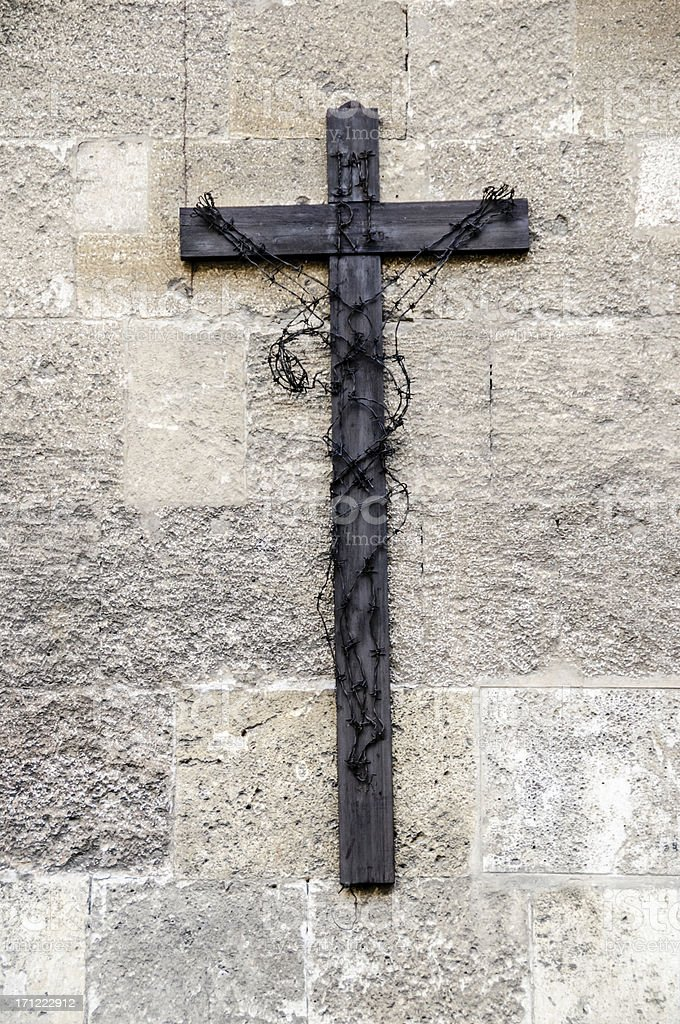 Crucifix wrapped in barbed wire stock photo