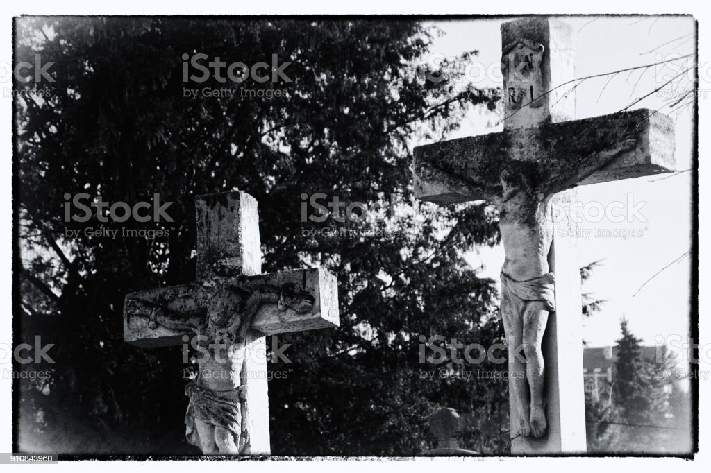 Crucifixion. A detail from an old cemetery. Post processed . stock photo