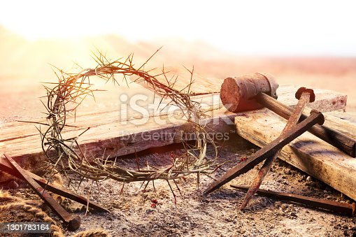 istock Crucifixion At Sunset  - Cross With Crown Of Thorns Hammer And Bloody Nails 1301783164