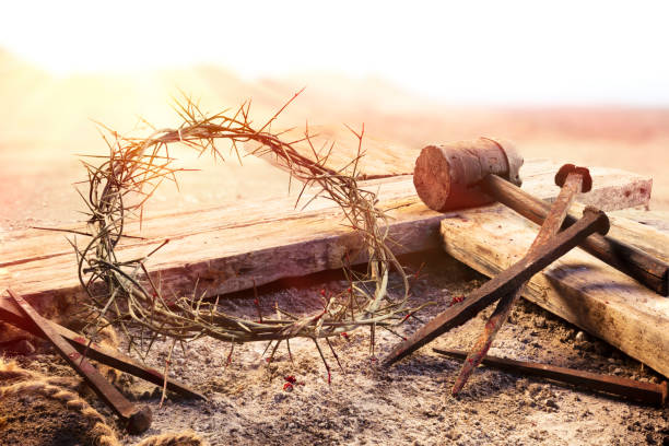 Crucifixion At Sunset  - Cross With Crown Of Thorns Hammer And Bloody Nails stock photo