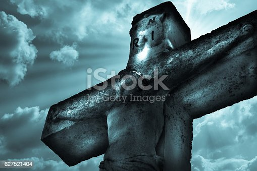 istock Crucifixion Jesus Christ statue on the sky background 627521404
