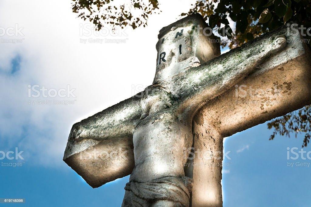 Crucifixion Jesus Christ statue. Sky background stock photo