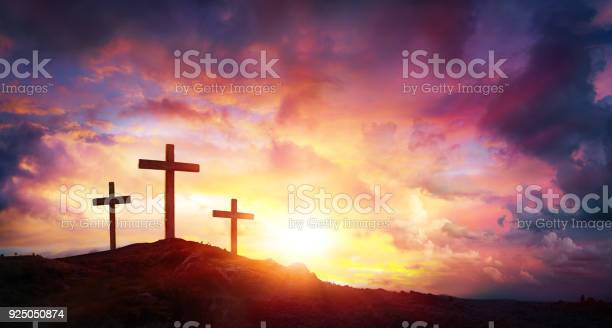 Three Crosses On Mountain With Red Clouds