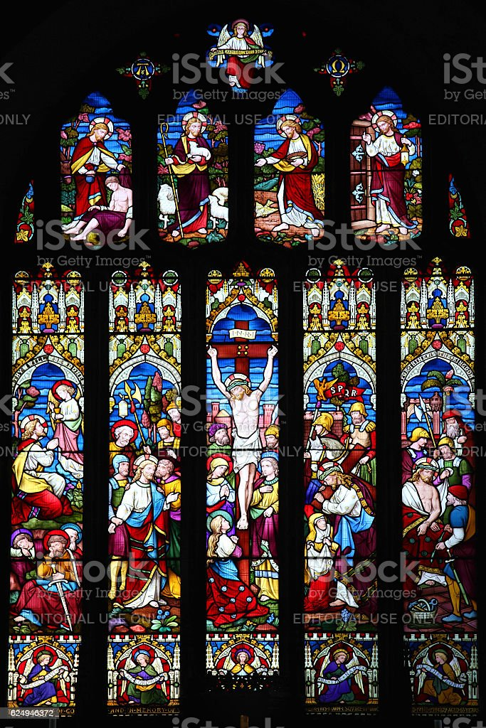Crucifixion of Jesus Christ on a stained glass window stock photo