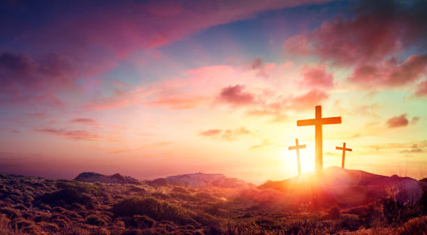 Crucifixion Of Jesus Christ  - Three Crosses On Hill At Sunset stock photo