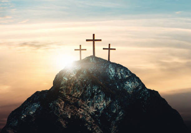 Crucifixion of Jesus Christ, three crosses on hill stock photo