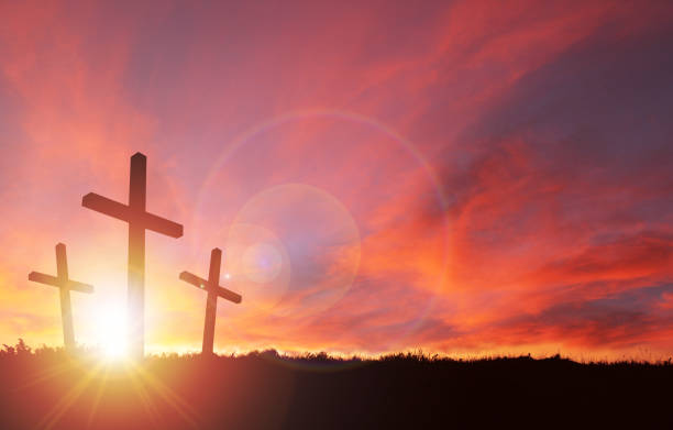 Crucifixion of Jesus With Sunset Sky and Copy Space stock photo