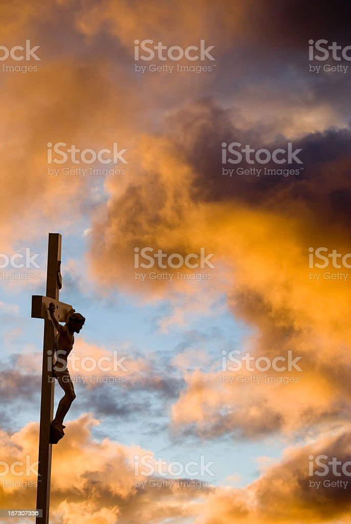 Crucifixion with gold clouds and Christ on the cross stock photo