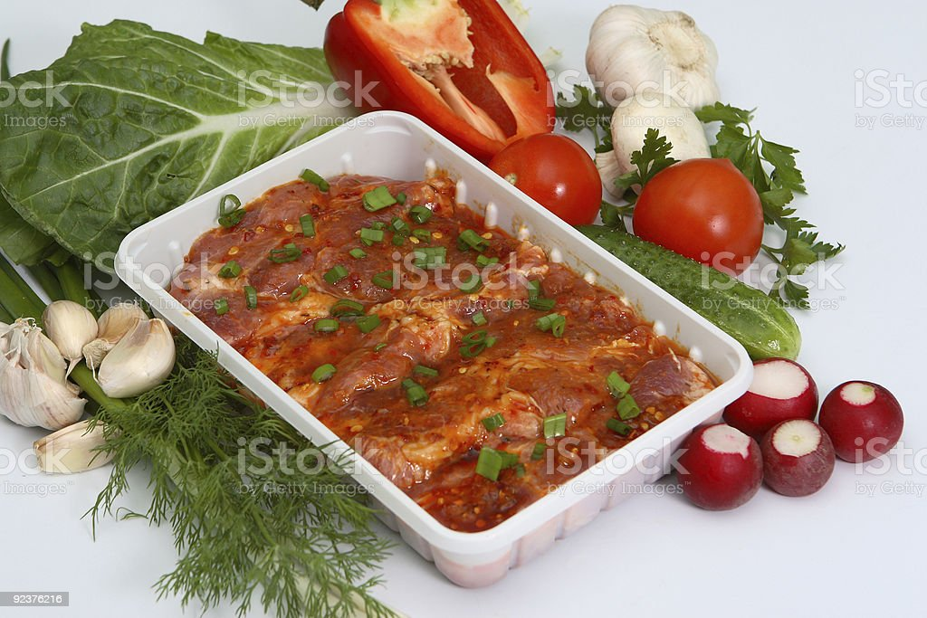 Crude meat with fresh vegetables, greens and seasoning royalty-free stock photo