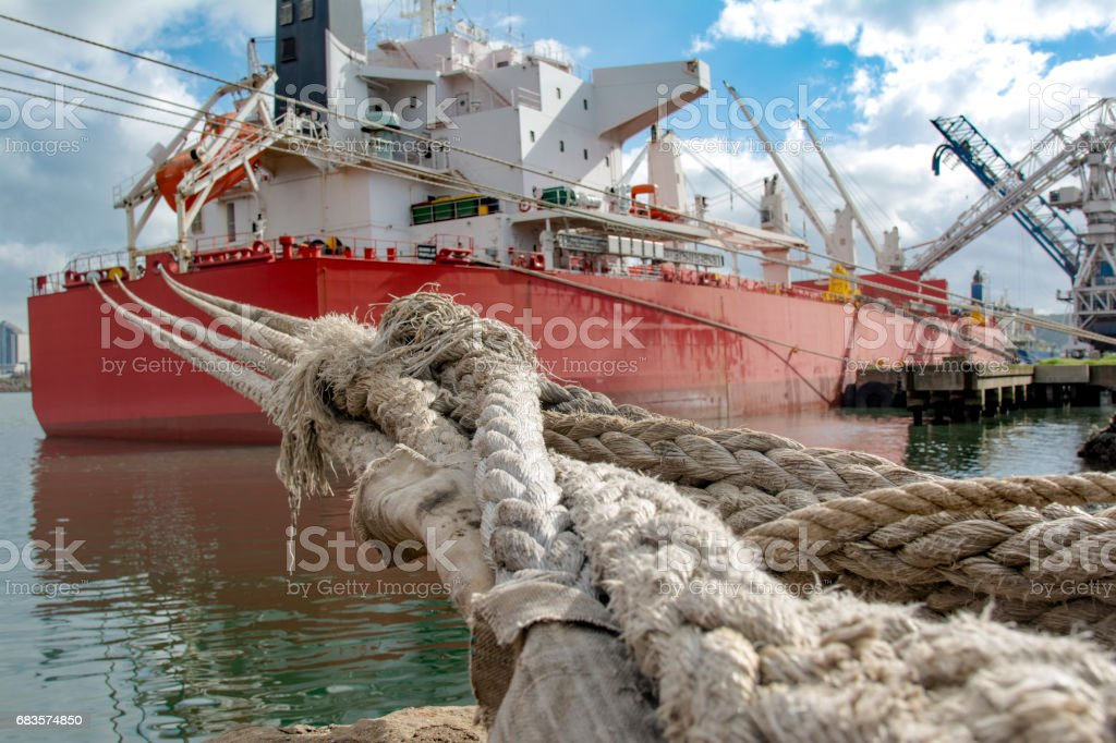 Crude oil tanker during loading operation in the port stock photo