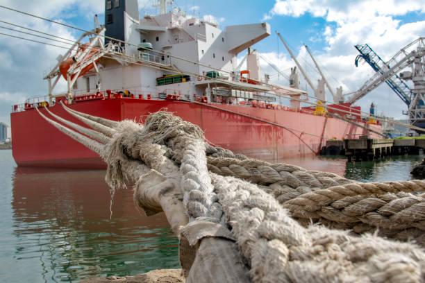 crude oil tanker during loading operation in the port - aangemeerd stockfoto's en -beelden