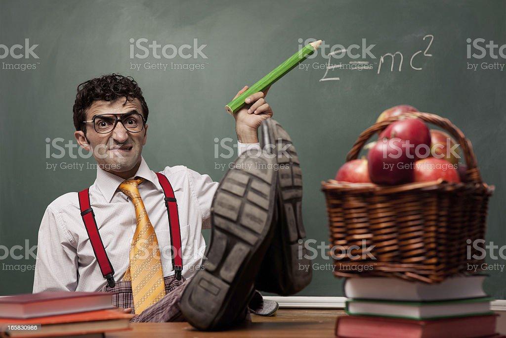 Cruel angry teacher sitting and teaching royalty-free stock photo