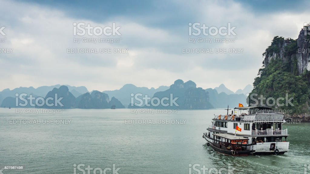 Cruise boat near rock islands in Halong Bay, Vietnam, Southeast Asia stock photo