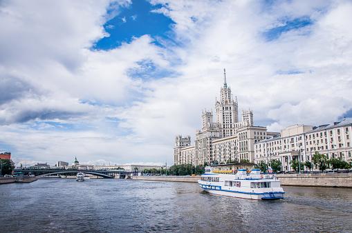 A Cruise Boat On Moskva River Near Kotelnicheskaya Embankment Building