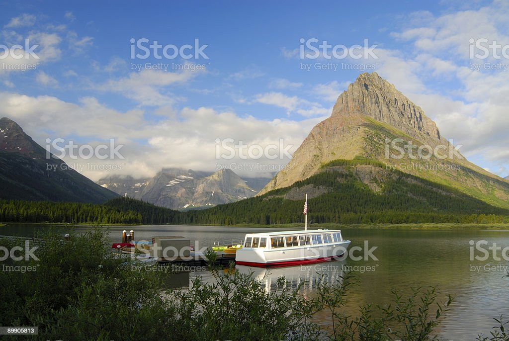 Cruise Boat on Swiftcurrent Lake royalty-free stock photo