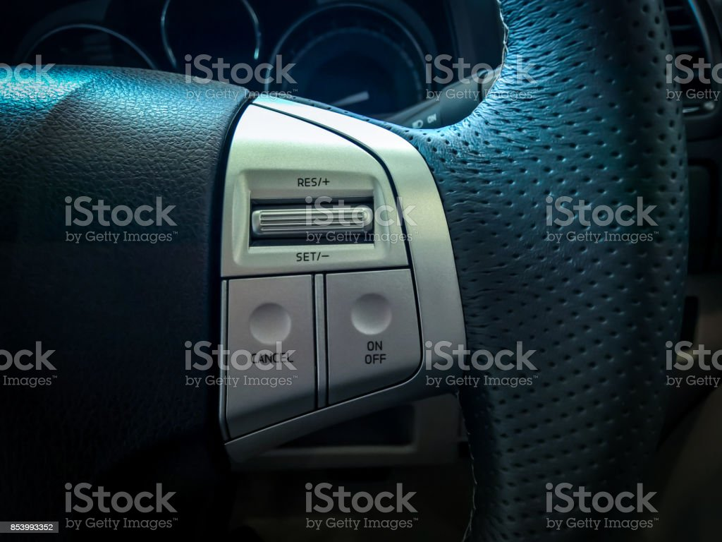 Cruise control on steering wheel stock photo