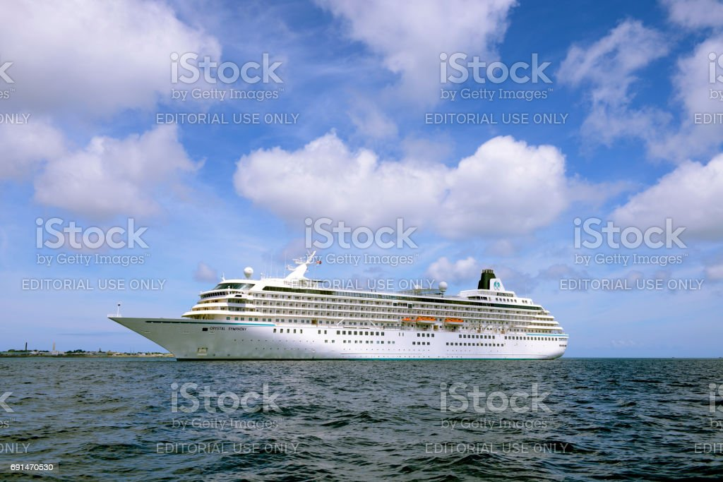 Cruise liner Crystal Symphony in St. Peter Port harbor. stock photo