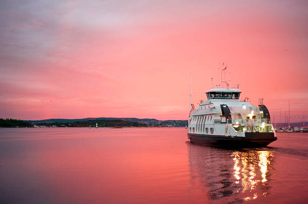 Cruise liner departuring from Oslo harbor Cruise liner floating away from the Olso harbor at dawn oslo stock pictures, royalty-free photos & images