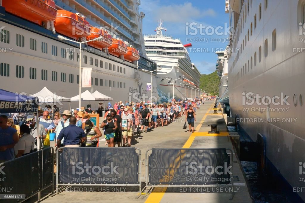 Cruise Passenger Wait on Security to Board Ship stock photo