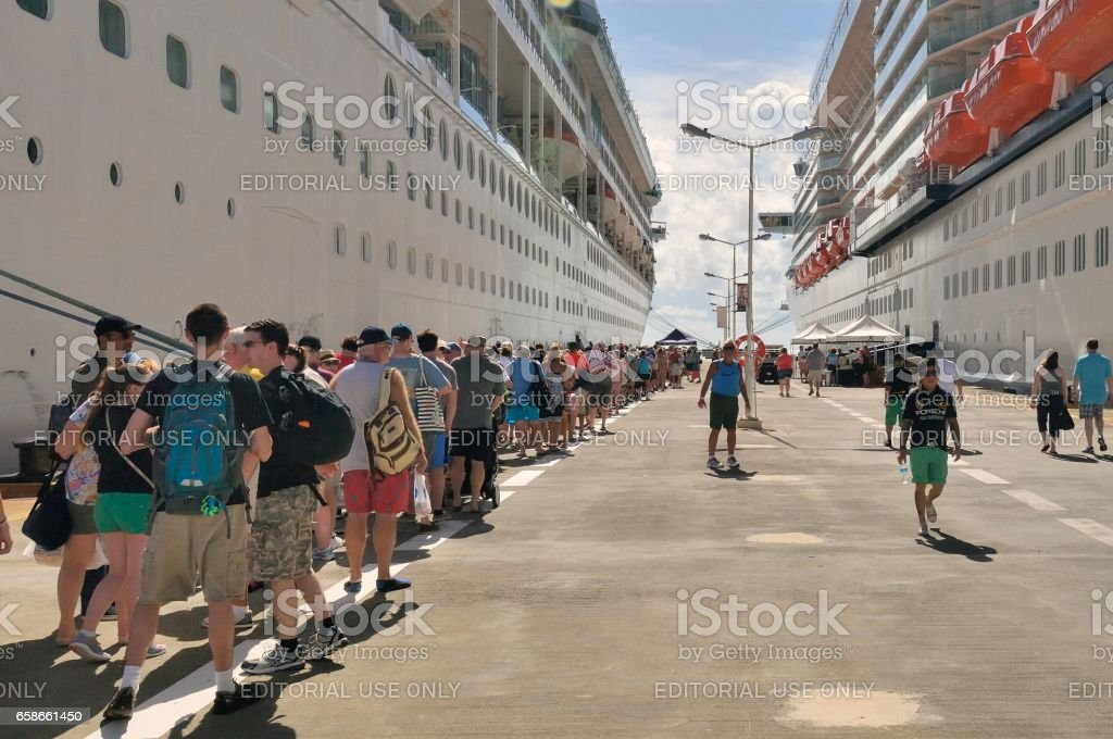 Cruise Passenger Wait to Board Ship stock photo