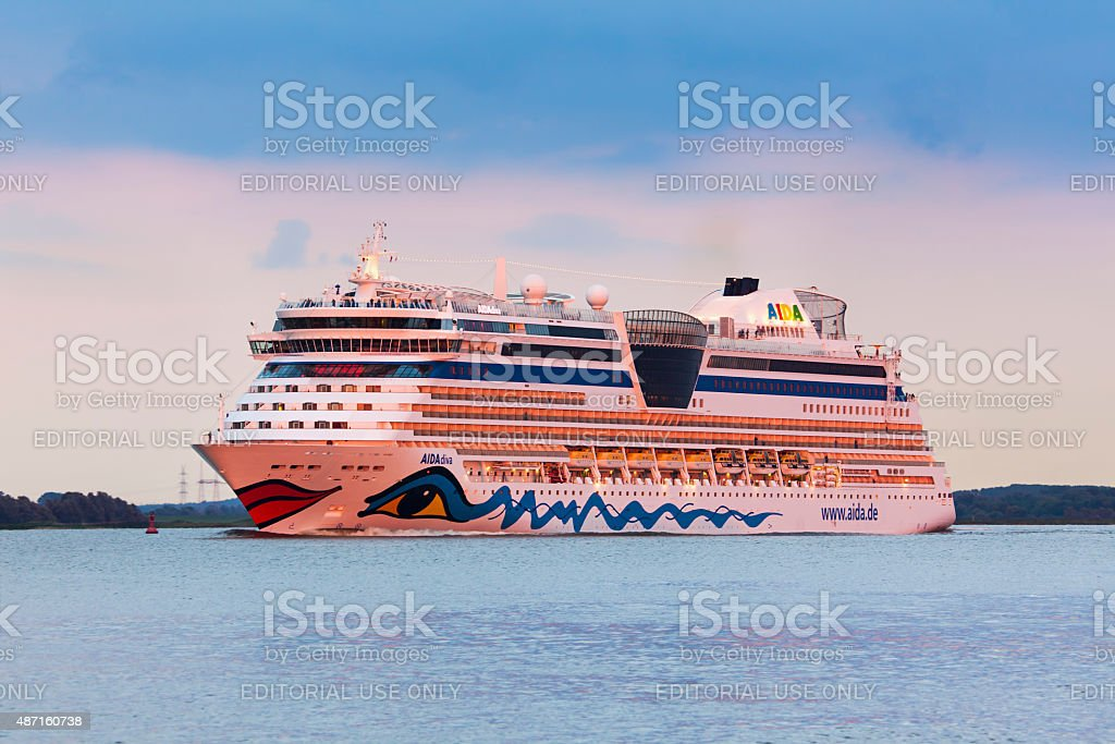 Cruise ship AIDAdiva on the Elbe river in sunset stock photo