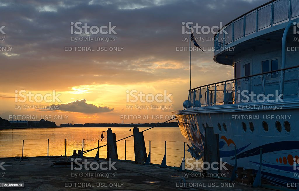 Cruise ship Alexander Benois on river berth at sunset, Rybinsk stock photo