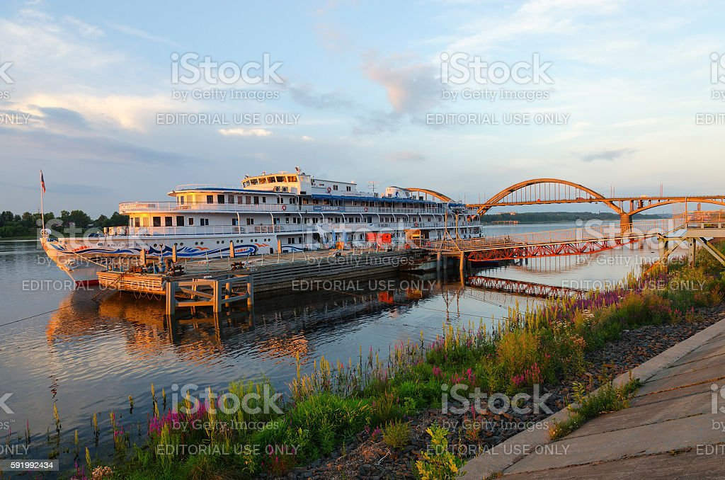 Cruise ship Alexander Benois on river quay at sunset, Rybinsk stock photo