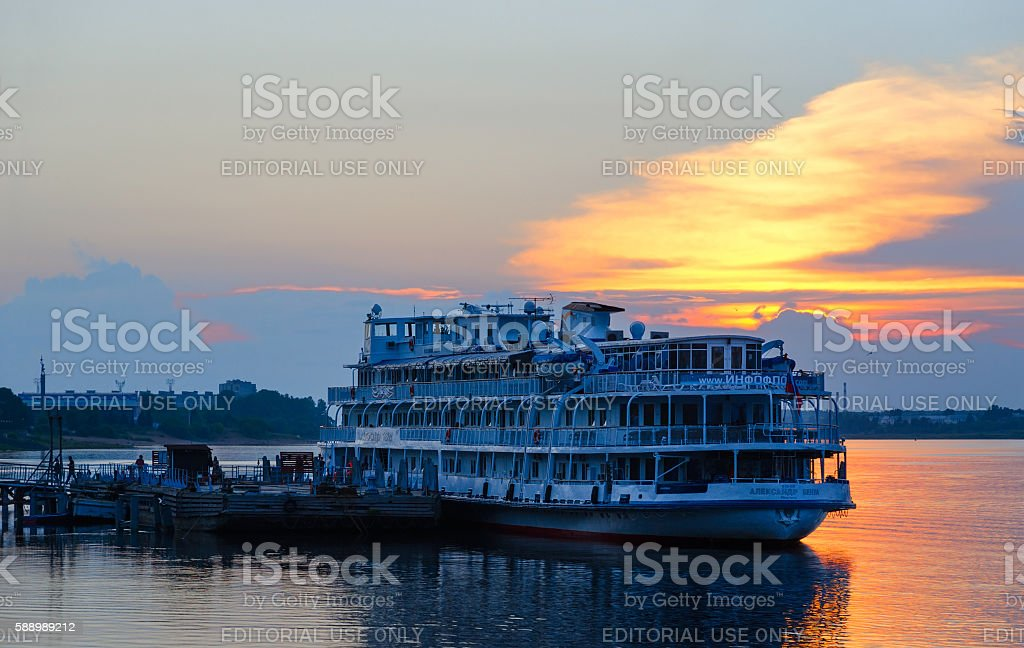 Cruise ship Alexandre Benois on river berth at sunset, Rybinsk stock photo