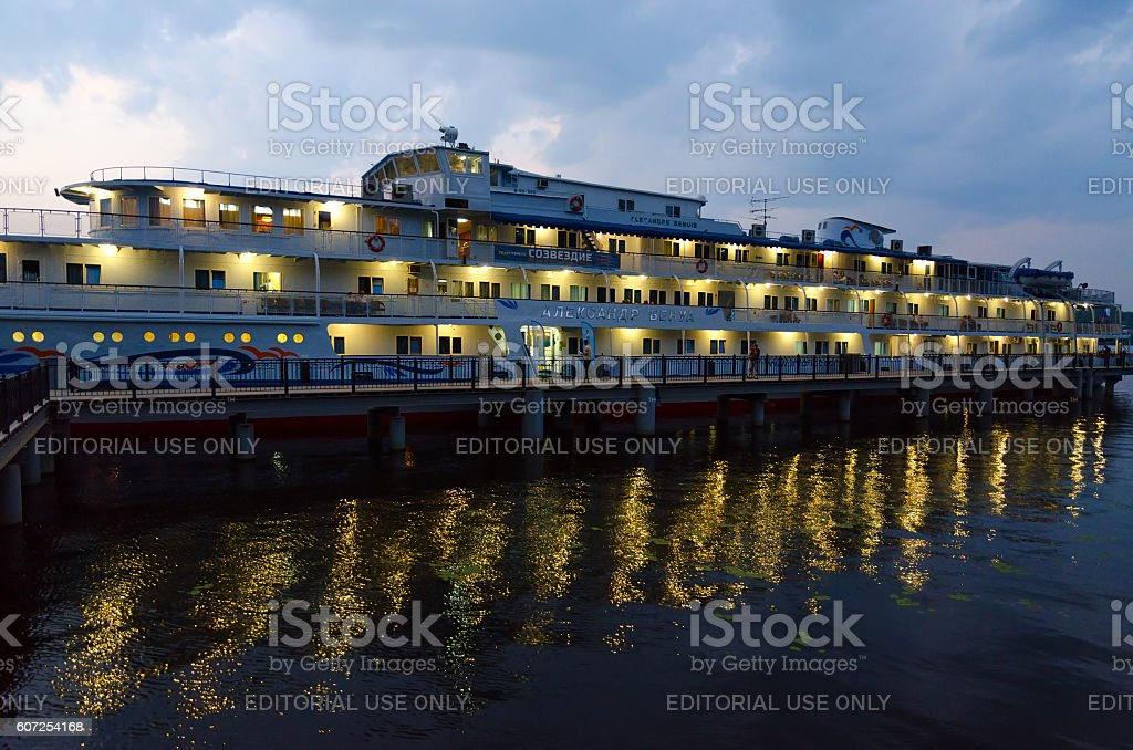 Cruise ship Alexandre Benois on river quay at night, Ples stock photo