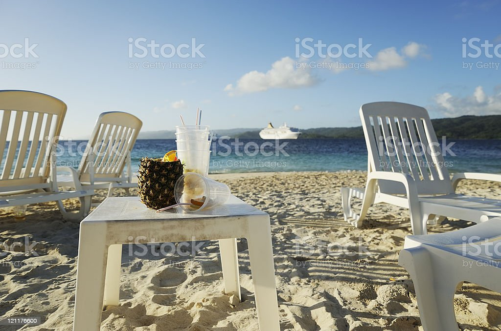 Cruise ship and messy beach royalty-free stock photo