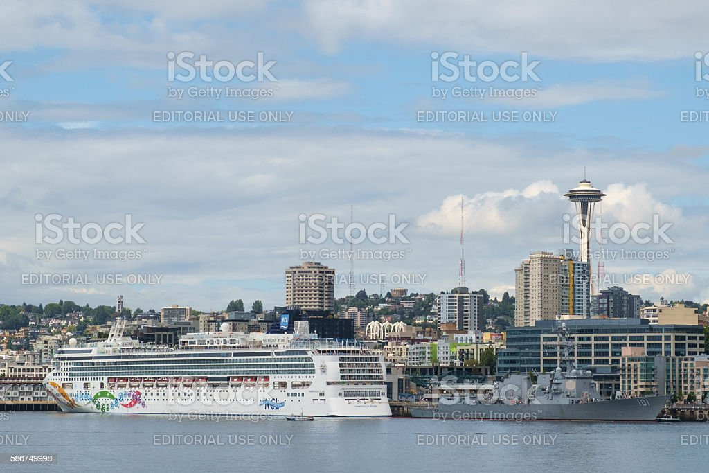 Cruise ship and US Navy Destroyer stock photo
