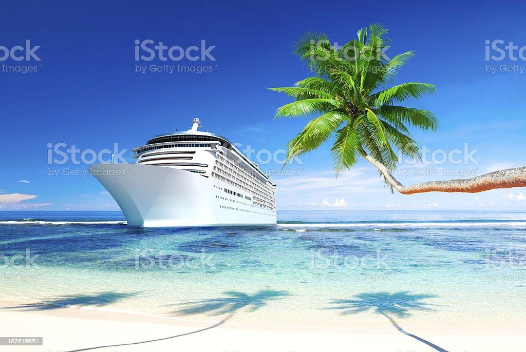 Cruise ship at bay of tropical island stock photo