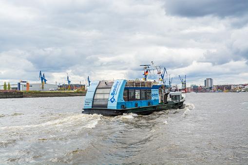 Cruise ship at the Elbe river, port of Hamburg, Germany.