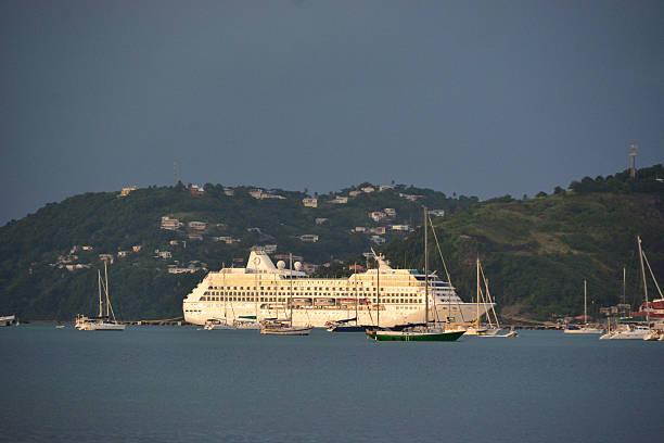 Cruise ship  at Tropical caribbean beach island stock photo