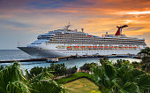 WILLEMSTAD, CURACAO - APRIL 04, 2018:  Cruise ship Carnival Conquest docked at port Willemstad on sunset.  The island is a popular Caribbean cruise destination