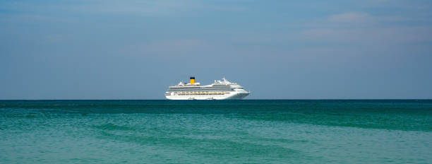 Cruise ship in the middle of the ocean stock photo
