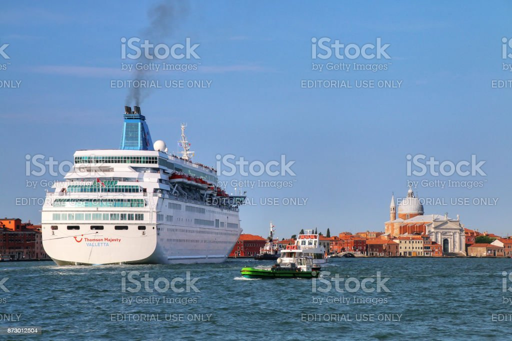 Cruise ship moving through Guidecca canal in Venice, Italy stock photo