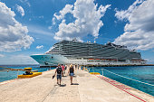 Cozumel, Mexico - April 24, 2019: Cruise passengers arrive to the cruise ship to check in and board the MSC Seaside Cruise Ship which sails from Cozumel to Miami.