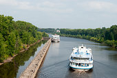 Uglich, Yaroslavl Region, Russia, August 1, 2013. Cruise ship on the Volga. Cruise ship in front of the gateway.
